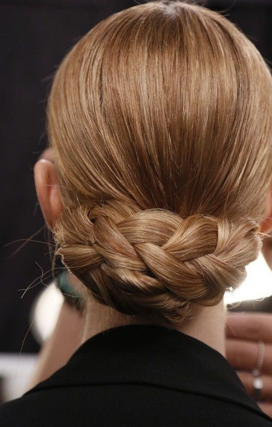 Take the low-slung chignon up a notch by adding a simple braid!