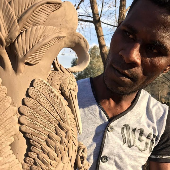 Thulani capturing the essence of the Delta with his Heron Vase. #Ardmore #ardmoreceramics #okavango #delta #ceramics #heron #vase #handsculpted #ardmoreartists