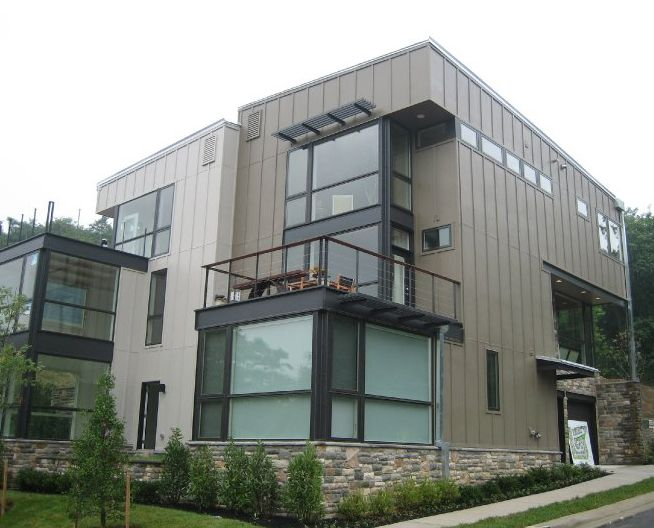 Hardie board and batten exterior siding on a modern house for Modern exterior materials