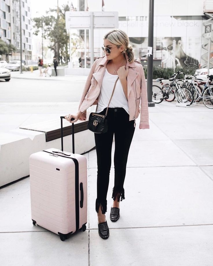 pastel pink leather jacket, pink luggage outfit