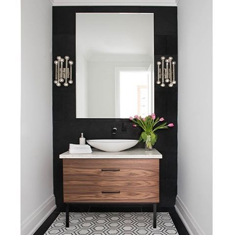Black accent walls might not always be your first thought - but when it works, it's amazing! As we can see by this Jodie Rosen Design bathroom featuring a Frosty Carrina countertop in a beautifully designed powder room.   Photo by Stephani Buchman.