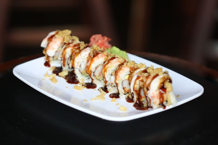The Crunchy Munchy Roll ~ Fried crab stick, cucumber, avocado, Sriracha, topped with tempura crunch, shrimp and eel sauce #sushi #fresh #drakes #malones #harrys #lexington