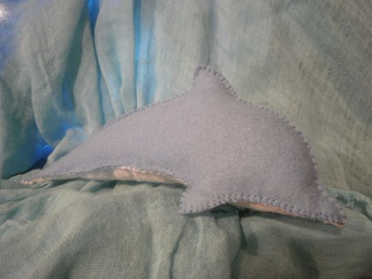 felt dolphin all ready to return to kindy.