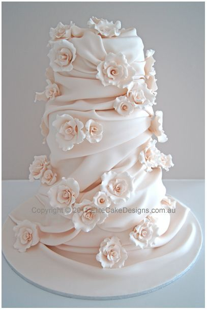 Equivalent to 6 tier wedding cake design featuring finely hand sugarcrafted roses