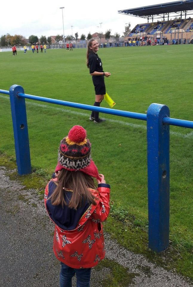 """The photographer wrote: """"Daughter was delighted to see this assistant referee today 'her hair is like mine, can I be a referee?'"""" October 14, 2017.  Photo credit: @hullablue — at Garforth Town A.F.C."""