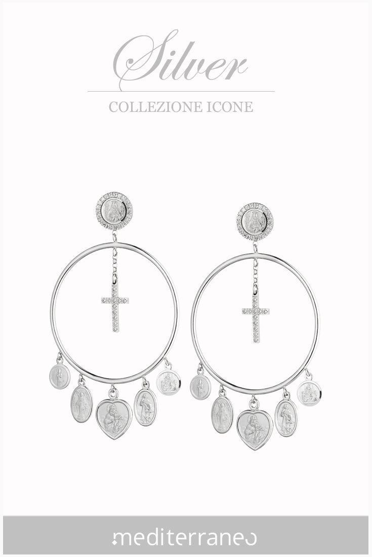 #orecchini in argento con medagliette religiose.
