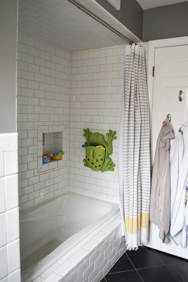 this bath toy holder is amazing for a million bath toys - also loving the hooks on the back of the door for kids' hooded towels