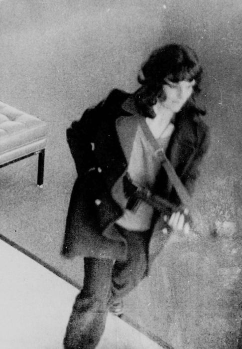 Patty Hearst of the Symbionese Liberation Army participating in the robbery of the Hibernia Bank, 1974.