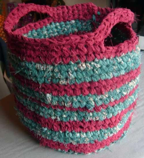 "Rag Basket. Crochet using 1"" strips cut from old cotton bed sheets. Would also make a nice rug!"