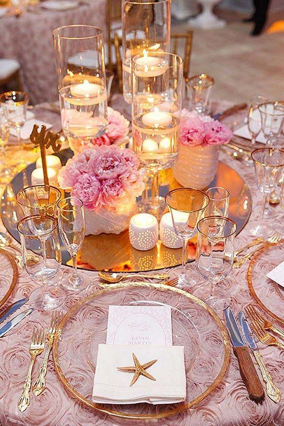 pink and gold beach wedding centerpiece via sabrina lightbourn photography / http://www.deerpearlflowers.com/fun-and-easy-beach-wedding-ideas/2/