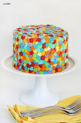 Made with the Wilton grass tip - I think it looks like yarn pom pom balls all over the cake.
