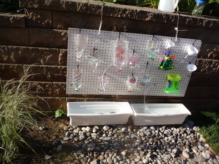 Toddler Water Wall. So much fun. We added river rocks under this which cuts down on mud and adds another natural element. This is another well loved area.