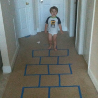 Indoor hopscotch with painters tape:)