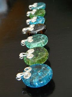 Cool idea : bake marbles and they become flat and look like these. These were made into necklaces