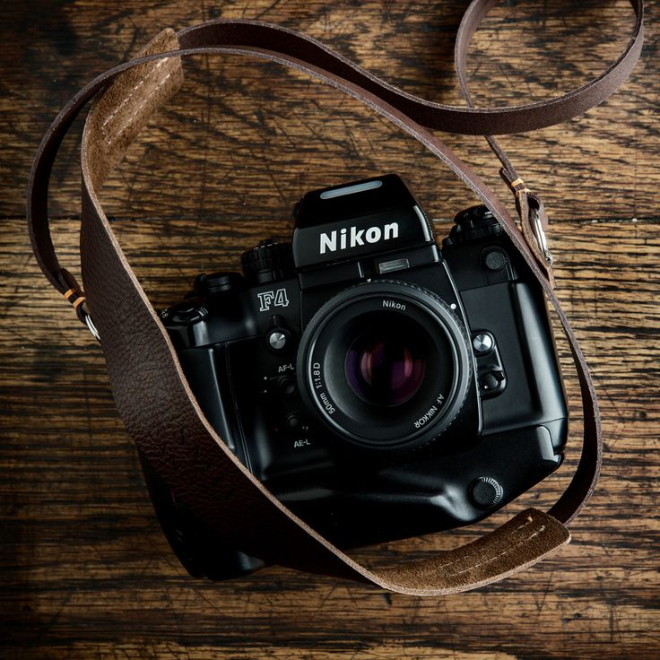 Nikon F4 with our handmade leather camera neck strap.