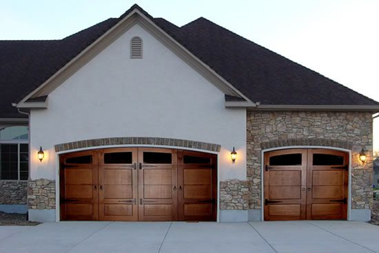 Carriage doors wooden, double with a single, use rectangle windows with divided light. I like the hardware and lay out of the wood