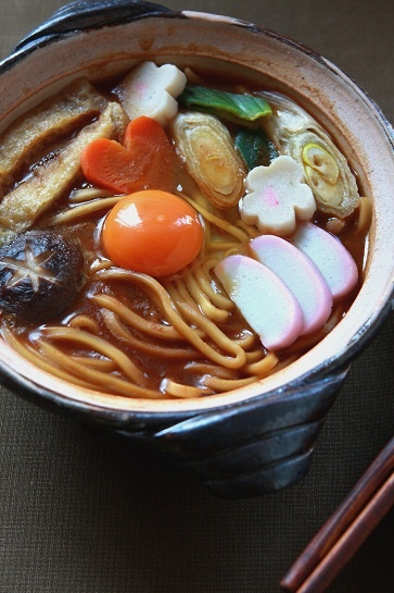 Warm udon noodle soup. Since we don't have narutomaki (that white-and-pink stuff) readily available in American markets, we could just do carrots, onions, chicken, and hard/soft boiled egg.