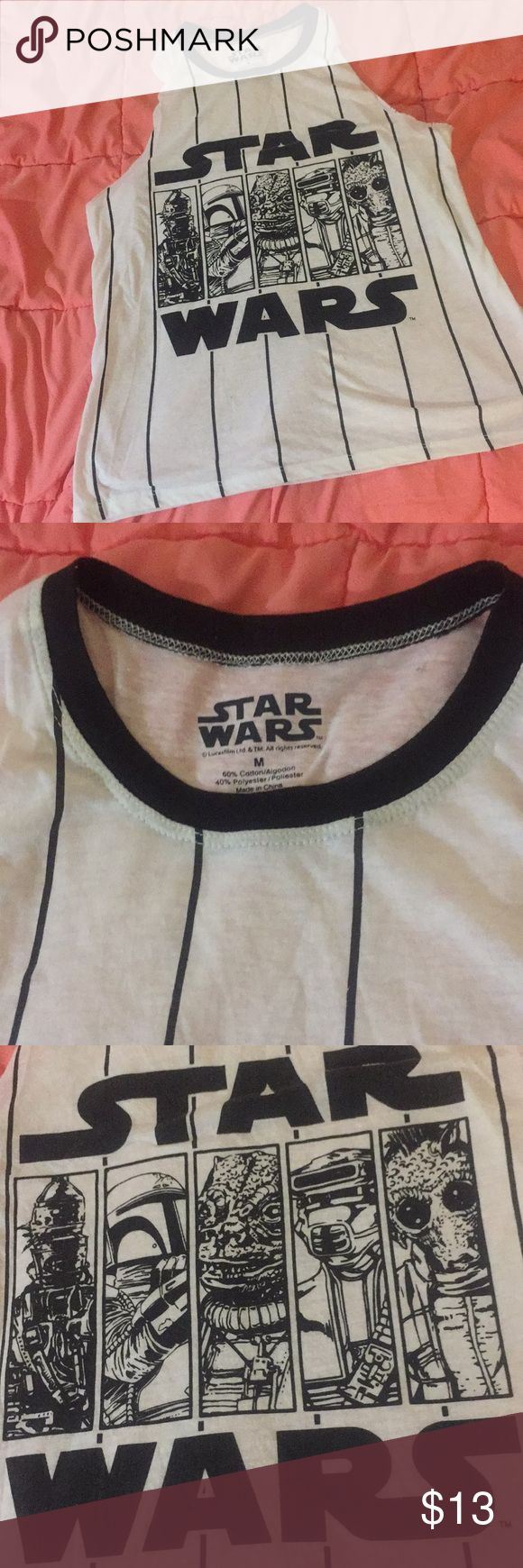 Star Wars Tank Star Wars custom cut tank  Official Star Wars Brand, Size M Vintage look, lightweight soft material   Great used condition, no flaws.  Great for collectors, fans, teens & adults!   Offering a generous bundle deal discount!  Always open to larger bundle deals.  All of my items are perfect condition unless other wise noted. Everything (that needs to be) is washed and steam ironed before shipping. ~ Cassandra ~ Star Wars Tops Tank Tops