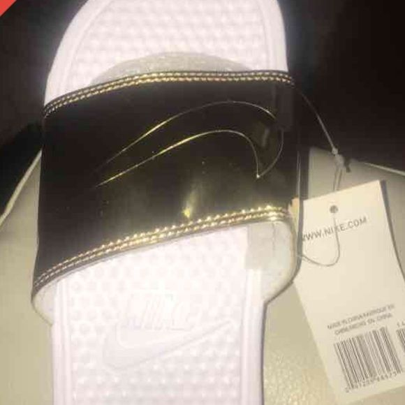 GOLD NIKE SLIDES MENS 8 WOMENS 9.5/10. WILL GO LOWER ON MERC Nike Shoes Sandals