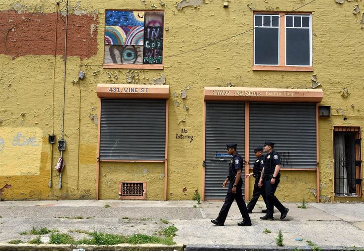Image: Camden County Police Department officers are seen on foot patrol in Camden