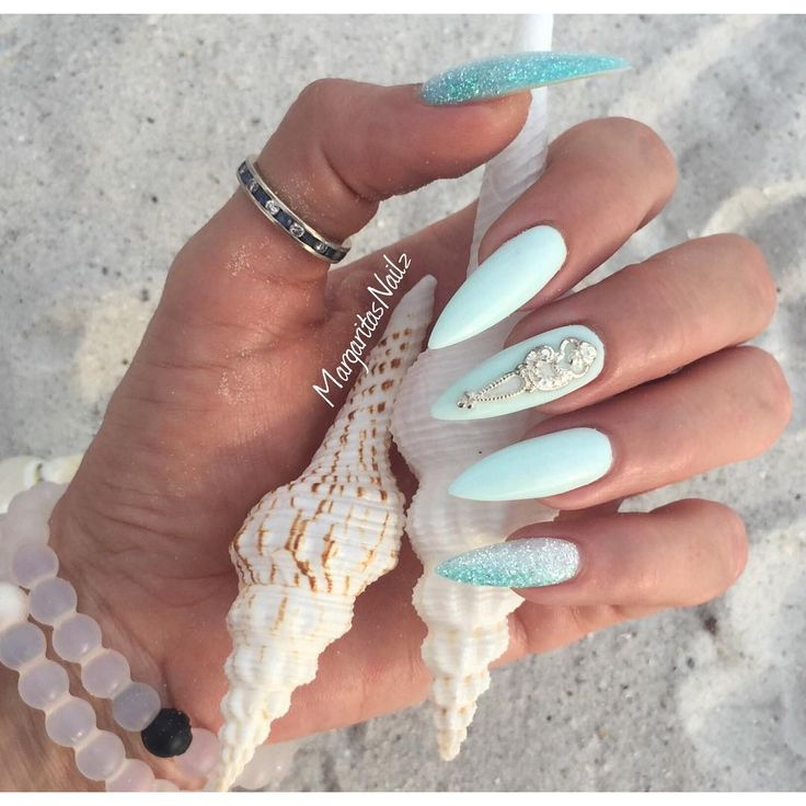 Tiffany Blue Stiletto Nails With Glitter and Silver Accents