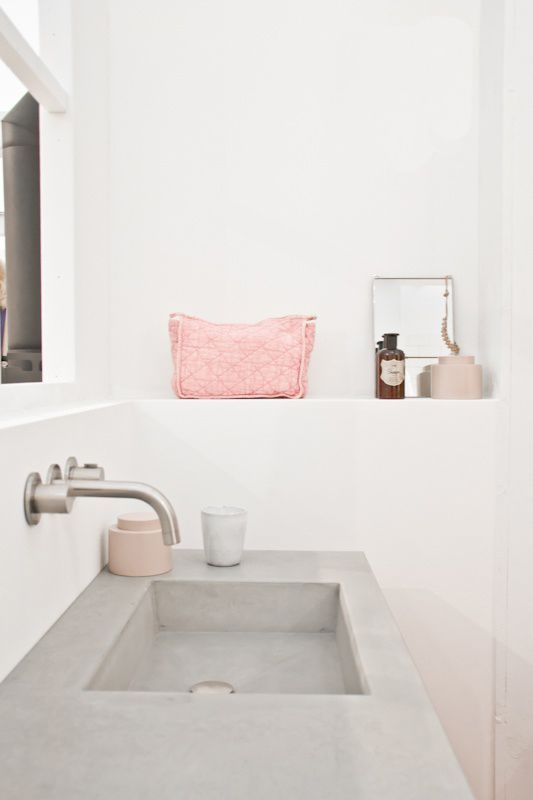 concrete sink in my ensuite with soft pastel accents.   #featheryournest @homesenseuk