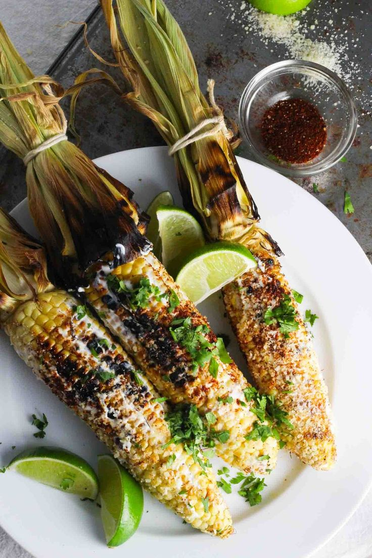 Mexican grilled corn with chili, cilantro and lime. Yum!