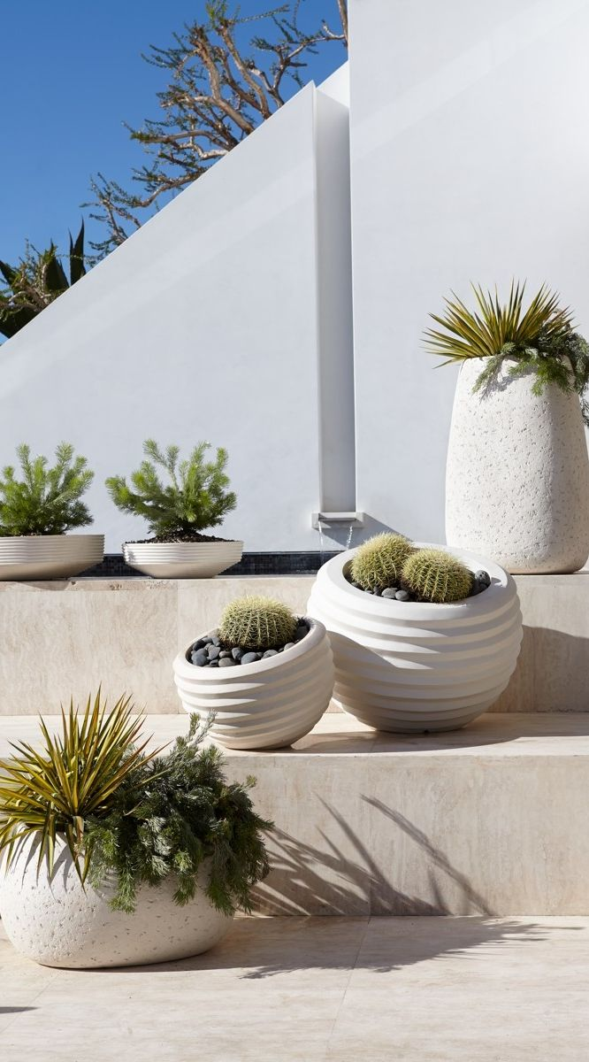 Modern meets natural in this assortment of planters  | Porta Forma