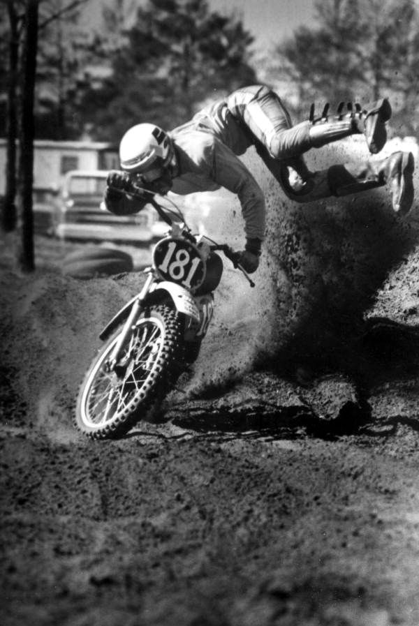 Motorcycle racer does stunts with his dirt bike (1977).  | Florida Memory