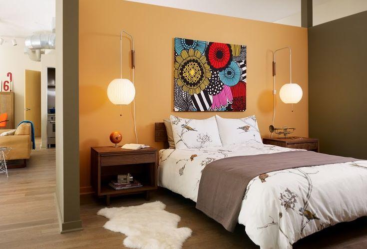 tangerine bedroom decor. Liked the wall lighting