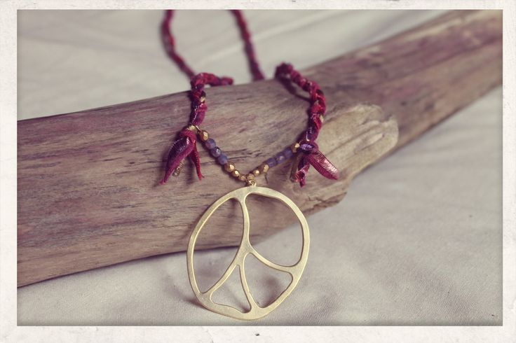 Braided with Love Necklace with 14k gold plated peace pendant!