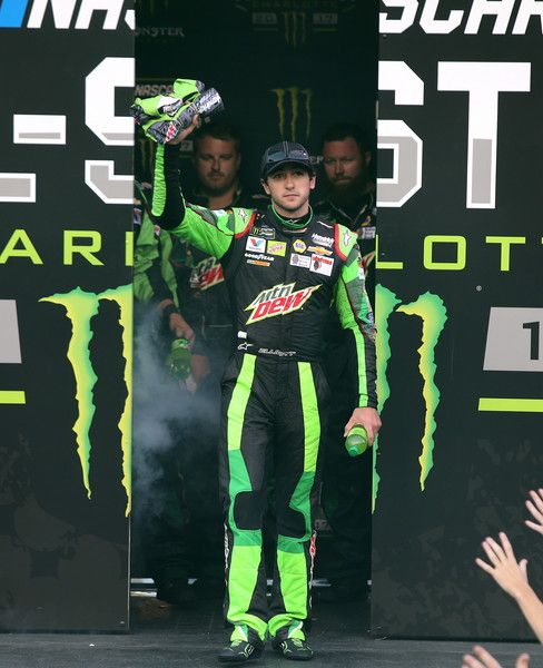 Chase Elliott Photos Photos - Chase Elliott, driver of the #24 Mountain Dew Chevrolet, walks across the stage prior to the Monster Energy NASCAR All Star Race at Charlotte Motor Speedway on May 20, 2017 in Charlotte, North Carolina. - Monster Energy Open & Monster Energy NASCAR Cup Series All-Star Race
