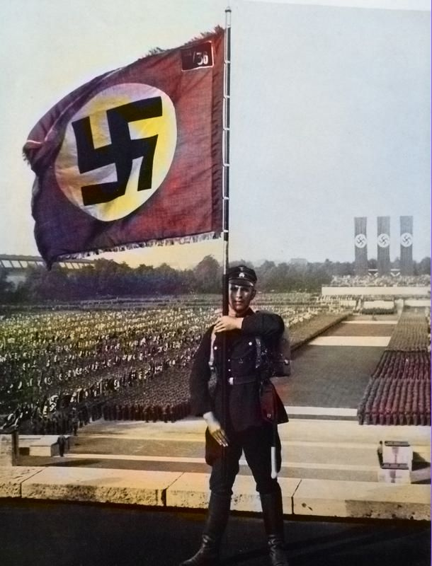 Colorized photo of a Nuremberg Rally with the flag being proudly displayed.