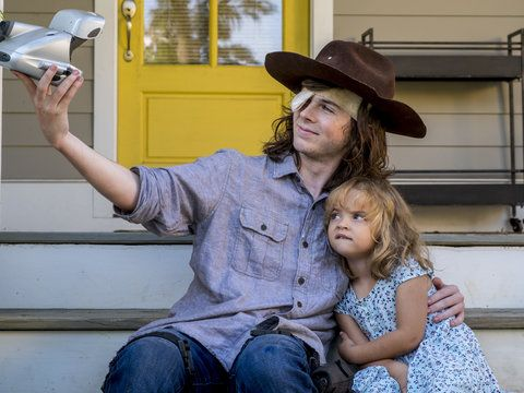 "AMC releases heartbreaking images of Chandler Riggs' character saying goodbye from the February 25, 2018 episode of ""The Walking Dead."""