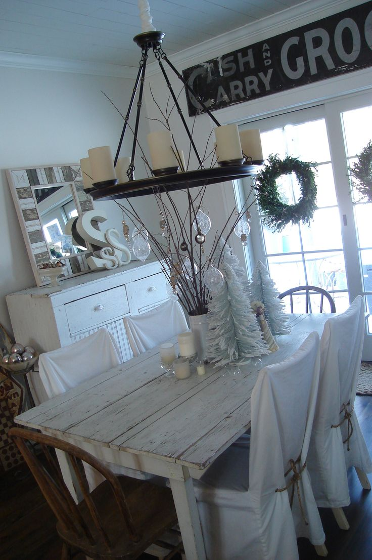 Kitchen table decor with small feather trees and decorated branches