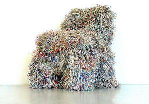 Oeuvre du designer, la chaise Hairy Chair, elle est la métaphore d'une époque prise entre l'ecodésastre et l'envie de faire renaitre un autre monde. Des chaises usagées sont habillées d'une sorte de fourrure faite de languettes de papier provenant de magazines, issues du laminage d'un broyeur de papier.