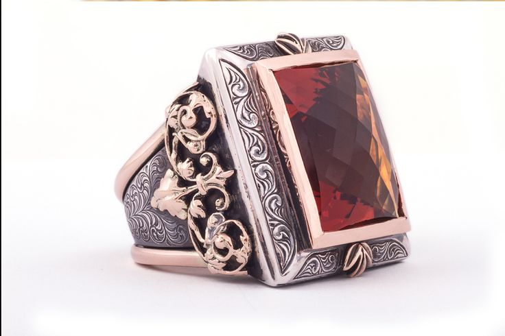 GALACIA DESIGNER JEWELLERY-Imperial topaz set in oxidized silver and red gold completed with hand engraving.