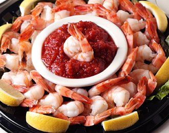 JUMBO SHRIMP COCKTAIL PLATTER~ a party favorite! Jumbo shrimp are booked in their shell with crab boil, cooled peeled, and chilled. Served cold with spicy cocktail sauce and lemon wedges.  Shrimp Cocktail Platter