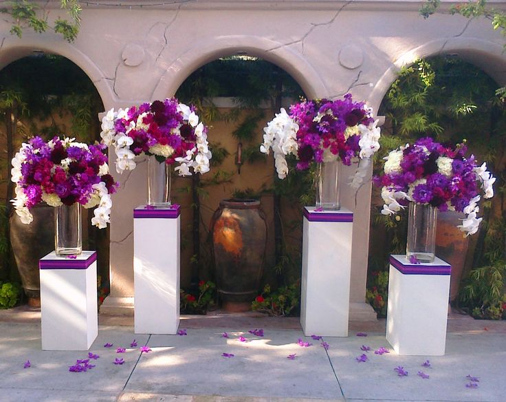 Gorgeous purple flowers at the altar ceremony flowers for Altar wedding decoration