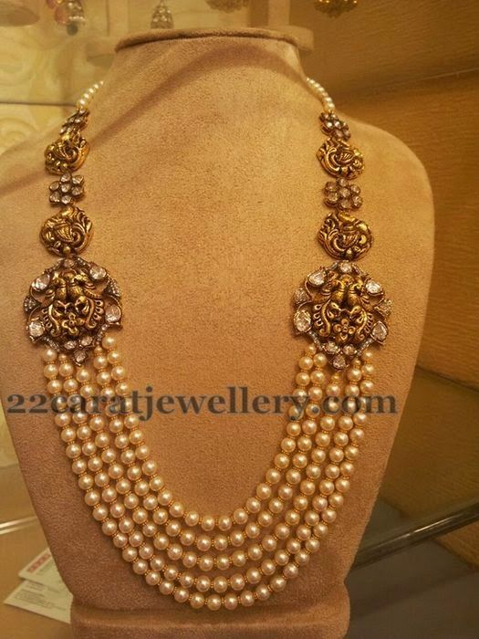 Jewellery Designs: Pearls Mala with Antique Motifs