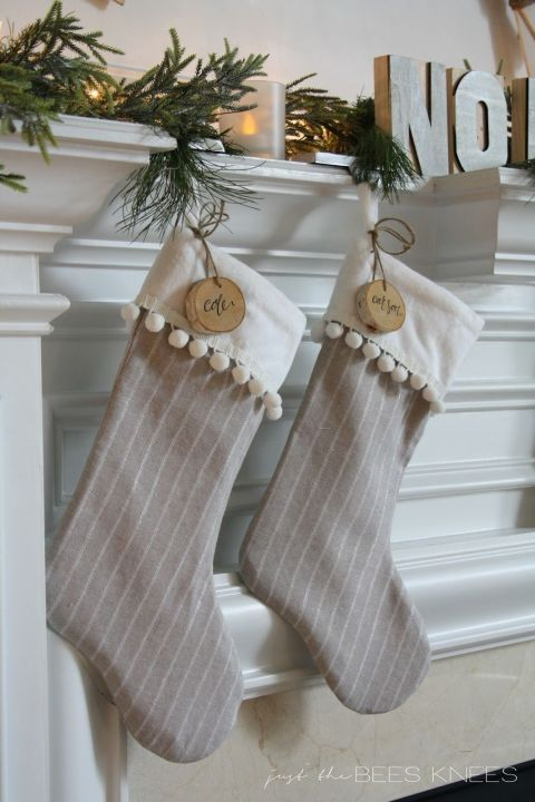 Before hanging, add some custom tags using birch slices and a sharpie for an adorably festive touch. It's a cute, personalized way to decorate your mantel this Christmas.