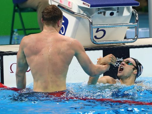 Adam Peaty (GBR) and Cody Miller (USA) celebrate after