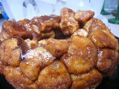 Campfire Monkey Bread in a dutch oven. Cook with 11 briquets on the bottom of each oven and 15-20 briquets placed around the outer rim of each lid. Bake for about 25 minutes. Remove the ovens from the bottom briquets and finish cooking with top heat only for approximately 10-15 minutes more.