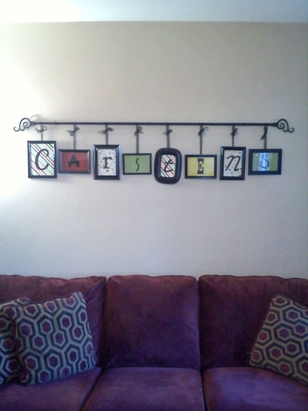 DONE for around $20! Dollar store picture frames, spray paint, scraps of scrapbook paper, Cricut cut letters, curtain rod, ribbon and eye hooks from Walmart.  LOVE IT! rudy917