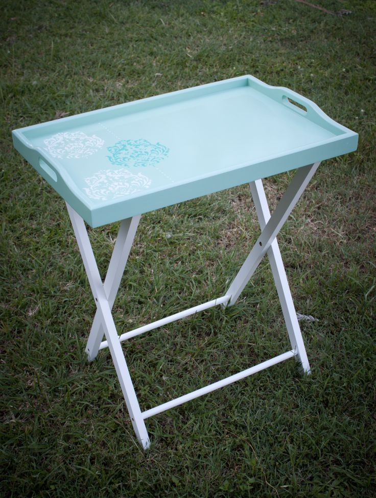 This tray table has been hand stencilled and painted in mint green with a high gloss finish. See Nine Stitches on Facebook for more pictures... https://www.facebook.com/pages/Nine-Stitches/1395225480724976