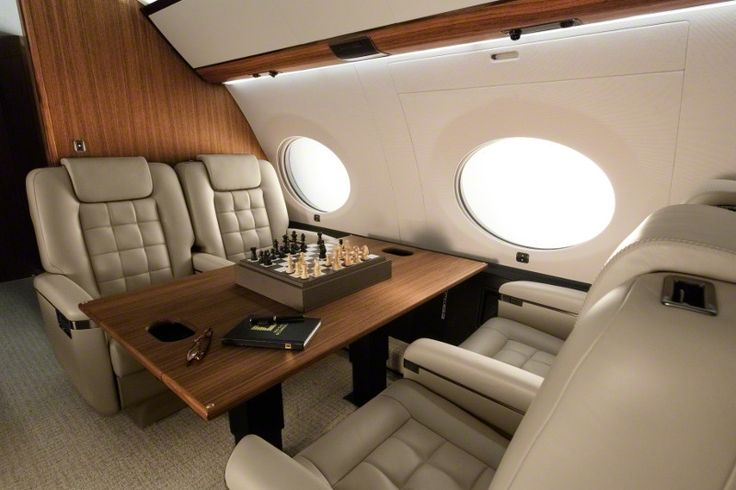 The four-living-area Gulfstream G650ER cabin is so quiet, you'll have no trouble concentrating.