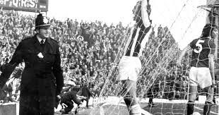 Astle scoring!! You can see the policeman is dying to join in the celebration!!