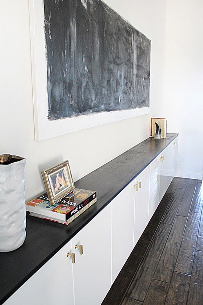 Poppytalk: 10 Awesome IKEA Hacks to Try - floating AKURUM cabinets - glossy finish top and brass hardware transforms it.