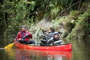 GENTLY DOWN THE STREAM: Television presenter Gus Roxburgh (in red) is filmed paddling on the Whanganui River. PHOTOS/ SUPPLIED