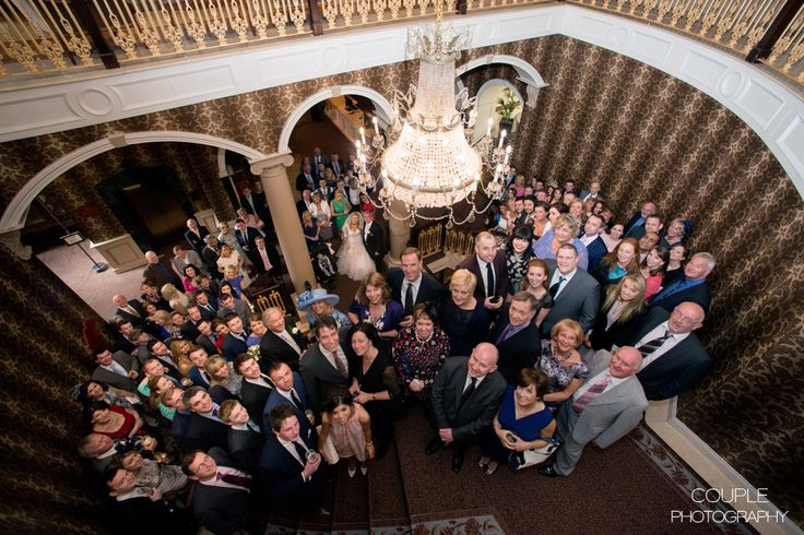 How many wedding guests can you fit n one photo? A huge group photograph of wedding guests on the staircase at Killashee. Weddings at Killashee House Hotel photographed by Couple Photography.